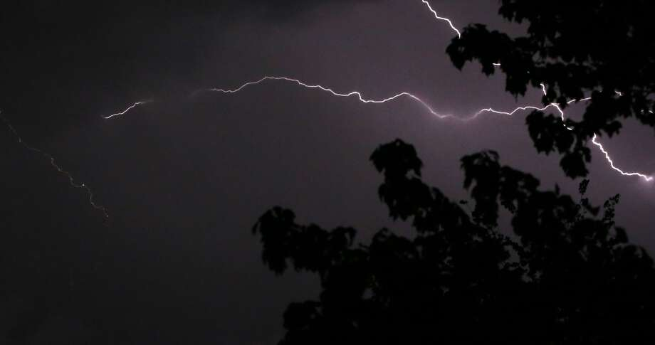 'X' marks the spot where bolts of lightning cross in the sky over Lawrence, Kan. Photo: Orlin Wagner, Associated Press