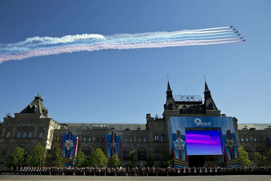 Victory Day in Russia:Russian Sukhoi Su-25 ground-attack planes release smoke in the 