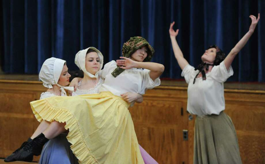 "Dancers, from left, Estelle Botella, Danielle Shupe, Yuki Imaizumi, and Melissa Weber perform a Quaker dance routine in which they ""shook off their sins"" during Connecticut Ballet's performance of ""American History Thru Dance and Verse"" at Hayestown Elementary School in Danbury, Conn. Friday, May 9, 2014.  The performance entertained students by taking them on a journey through American history, from Colonial to modern day, using dance and and writing as a platform.  The dancers dressed differently depending on the era of each dance and Artistic Director Brett Raphael narrated the program, giving context about each style of dance.  Connecticut Ballet is making a tour through Danbury, performing at 11 area schools from May 5 through May 14. Photo: Tyler Sizemore / The News-Times"