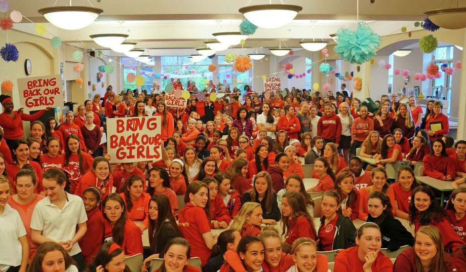 Upper-school and middle-school students (about 570 total) gather in Convent of the Sacred Heart's dining room Friday morning for a prayer and demonstration in support of the kidnapped Nigerian girls. Photo: Paul Schott, Anne W. Semmes / Greenwich Time