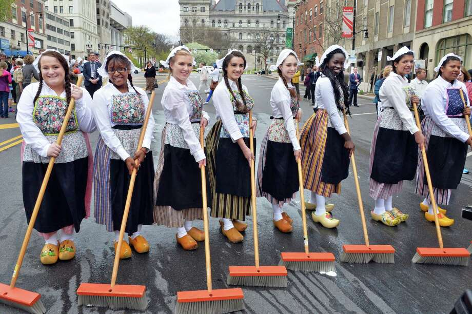 Albany High School seniors, from left, Anne Marie DeRusso, Monaijsha McCall, Egan McCoy, Jeannie Ringwald,  Vivian Munafo, Afua Sarfo, Morgan Heyward and Jayda Bryant-Bonarrigo carry out the traditional Dutch tradition of scrubbing the streets Friday May 9, 2014, to kick off the annual Tulip Festival in Albany, NY.  (John Carl D'Annibale / Times Union) Photo: John Carl D'Annibale / 00026799A