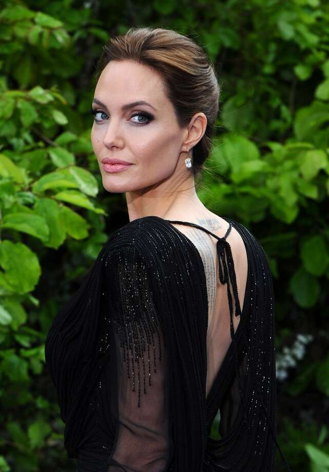 "Angelina Jolie attends a private reception as costumes and props from Disney's ""Maleficent"" are exhibited in support of Great Ormond Street Hospital at Kensington Palace on May 8, 2014 in London, England. Photo: Anthony Harvey, Getty Images"