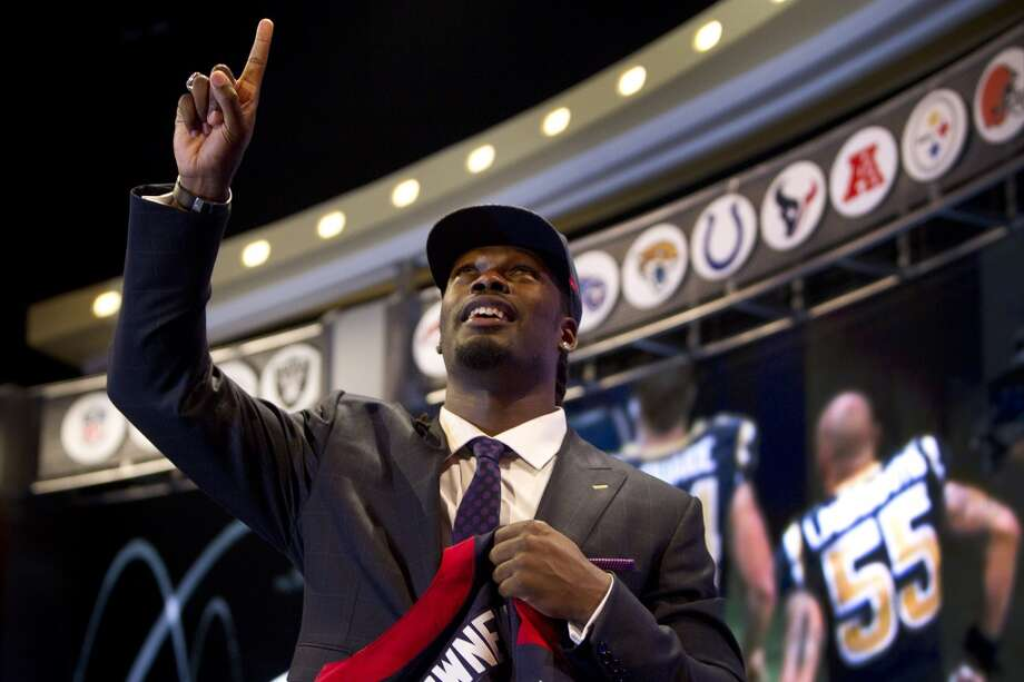 Jadeveon Clowney points skyward as he celebrates after being selected by the Houston Texans as the No. 1 overall draft pick. Photo: Brett Coomer, Houston Chronicle