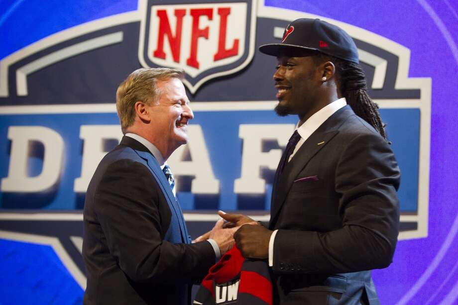 NFL Commissioner Roger Goodell, left, greets Jadeveon Clowney after he was selected by the Houston Texans as the No. 1 overall draft pick. Photo: Brett Coomer, Houston Chronicle