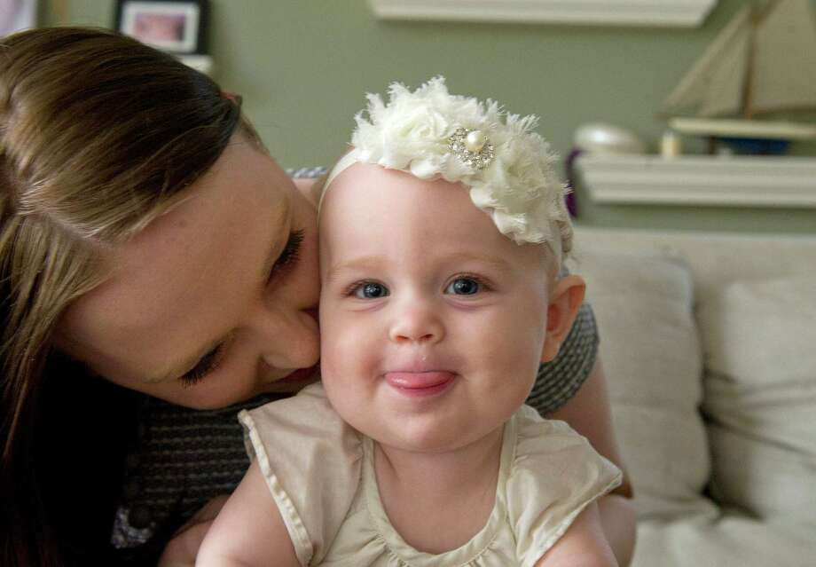 Stay-at-home mom Jennifer Cannizzaro plays with her daughter, Sara, in Stamford, Conn., on Saturday, May 3, 2014. Photo: Lindsay Perry / Stamford Advocate