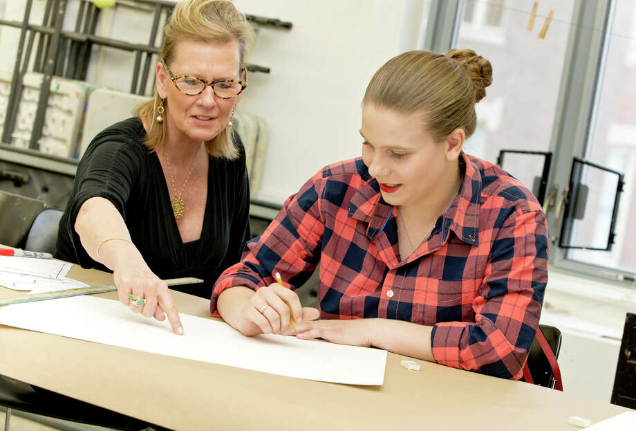 Greenwich artist Mary Newcomb instructs Bridgeport Central High School student, Vanessa Morais, on perspective drawing techniques during an outreach program at the Greenwich Art Society in Greenwich on Friday, May 9, 2014 Photo: Amy Mortensen / Connecticut Post Freelance