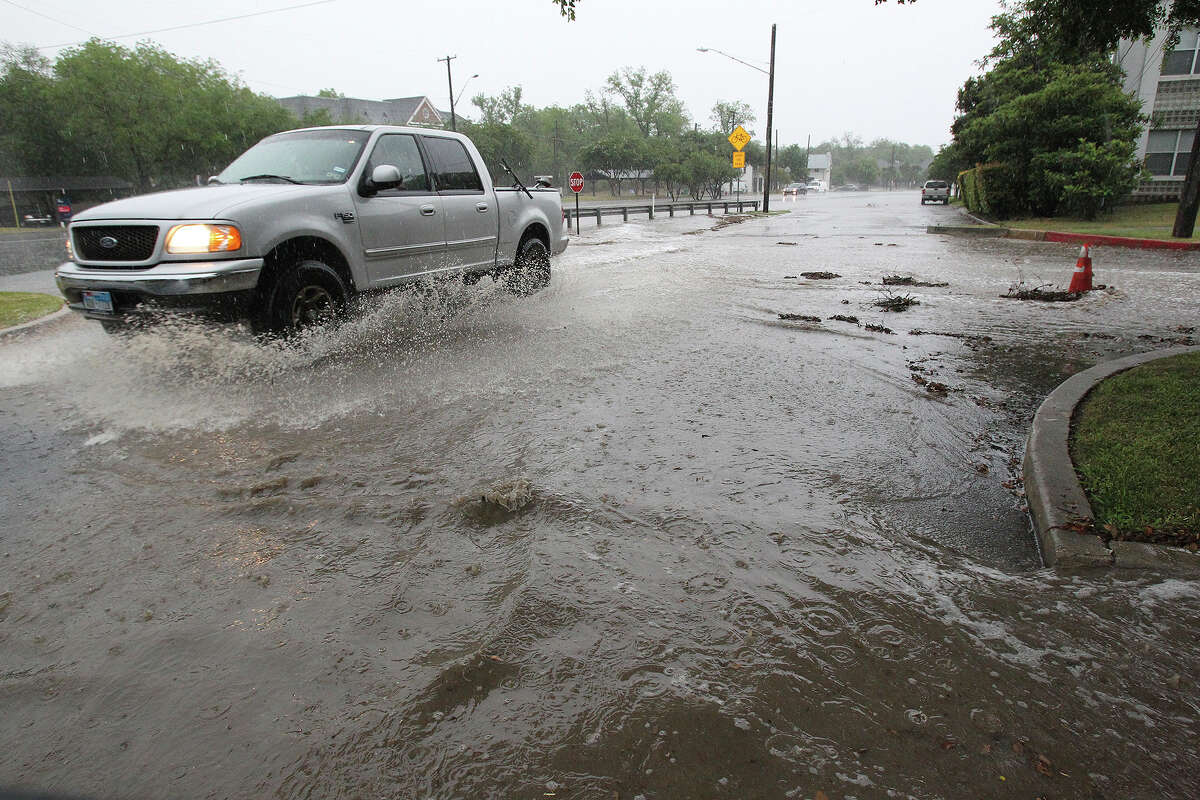 San Antonio came in second among U.S. cities with tailgate thefts with 125 insurance claims.Pictured, rain water rushes off the higher streets in Alamo Heights down onto the Autin Highway area as a line of thundershowers passes through San Antonio on Friday afternoon, May 9, 2014.