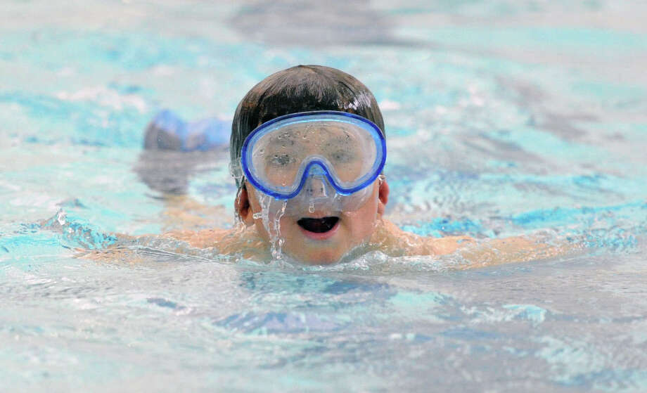 David Berrocal, 6, uses a dive mask while participating in the free swim at the Boys & Girls Club of Greenwich pool, Friday afternoon, May 9, 2014. Berrocal's mother, Dawn Berrocal, is the club aquatics director, and she said the free swim takes place Monday through Friday from 3:30 p.m. to 4:20 p.m. and is open to all club members. Photo: Bob Luckey / Greenwich Time