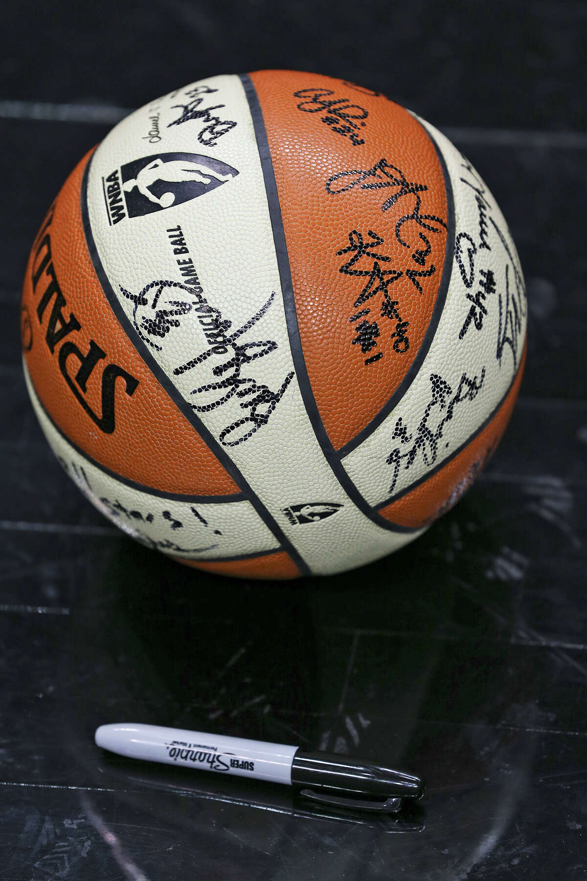 A signed basketball rests court side as Stars hold media day at the AT&T Center May 9, 2014.