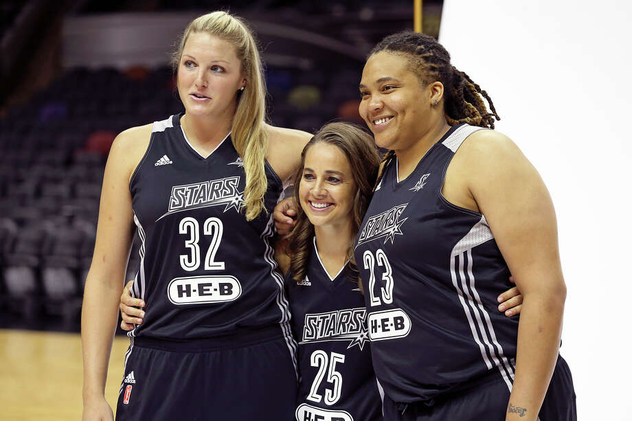 Becky Hammon is surrounded by forwards Jayne Appel (left) and Danielle Adams as the Stars hold media day at the AT&T Center May 9, 2014. Photo: TOM REEL