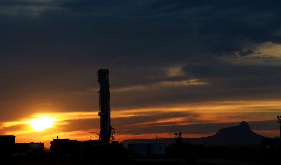 The sun rises behind a Barrett Brothers independent drilling rig in Presidio County between Alpine and Marfa. Photo: John Davenport / San Antonio Express-News / ©San Antonio Express-News/Photo may be sold to the public