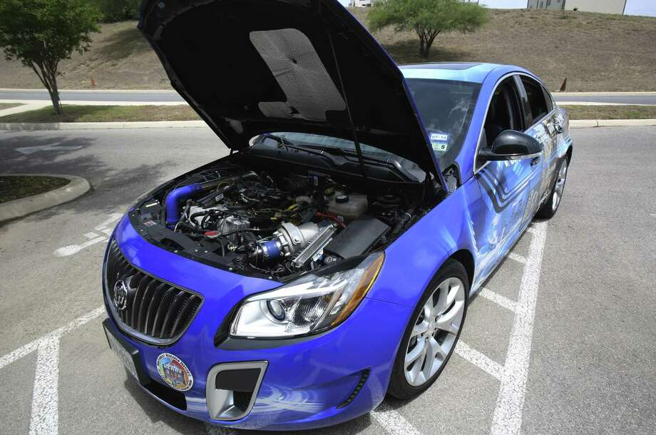 SwRI's Buick demonstrator went to the Society of Automobile Engineers World Congress in Detroit where it was test-driven. Photo: Helen L. Montoya, San Antonio Express-News / ©2014 San Antonio Express-News