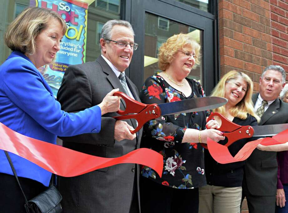 Cutting the ribbon for the century-old travel agent, Birkmayer Travel, which moved to larger quarters are from left: Renss. Co. Exec Kathy Jimino, Troy Mayor Lou Rosamilia, Birkmayer owner Elana Glinert, travel agent Candy Lent and Assemblyman John McDonald at City Station Friday, May 9, 2014, in Troy, N.Y.  (John Carl D'Annibale / Times Union) Photo: John Carl D'Annibale / 00026840A
