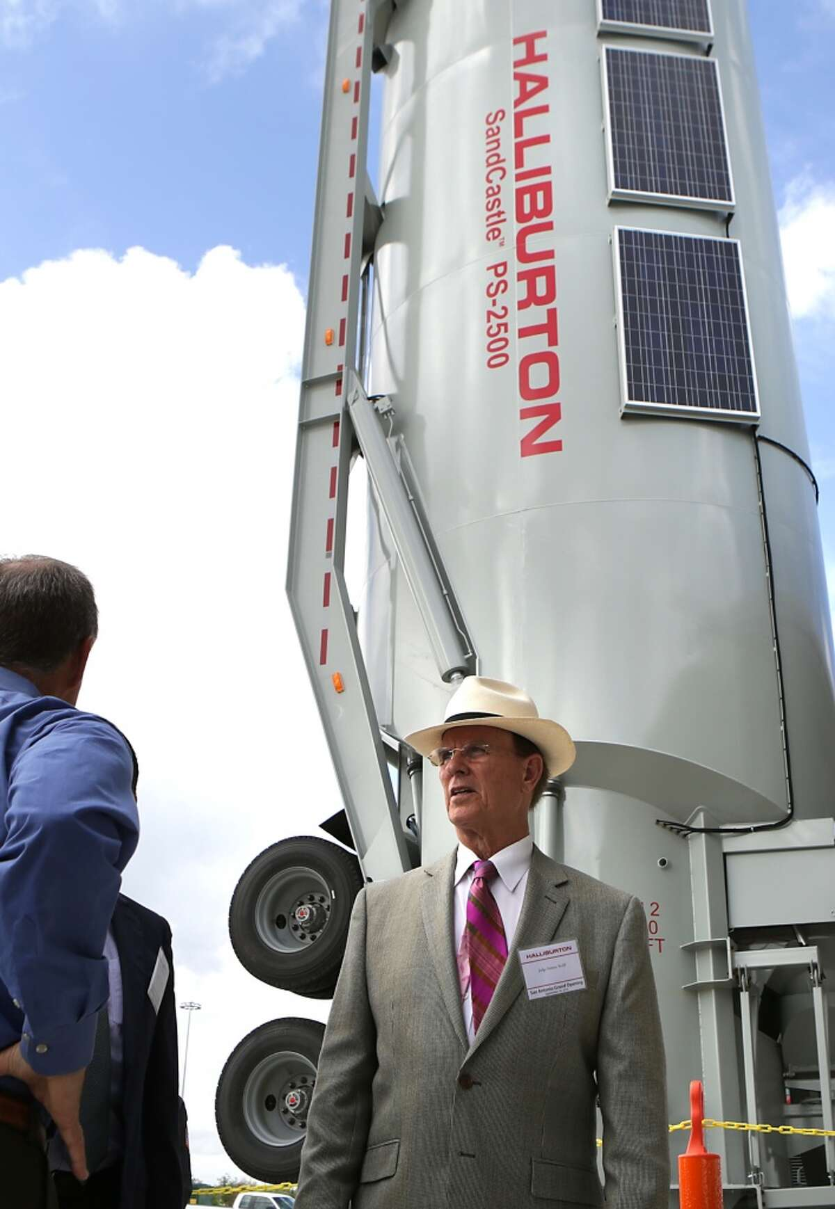 Oil field services giant Halliburton, headquartered in Houston, gives 90.2 percent of its political contributions to Republican candidates and committees. [Photo: Bexar County Judge Nelson Wolff arrives at Halliburton's San Antonio Operations Center for its grand opening in September 2013.]