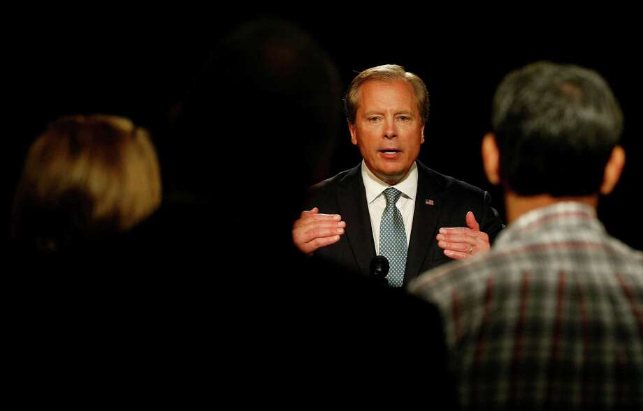 May 7, 2014: Lt. Governor David Dewhurst takes questions from reporters after debating with state Senator Dan Patrick for the GOP lieutenant governor race at WFAA studio in Dallas. (AP Photo/Star-Telegram, Khampha Bouaphanh) Photo: Khampha Bouaphanh, MBI / Star-Telegram