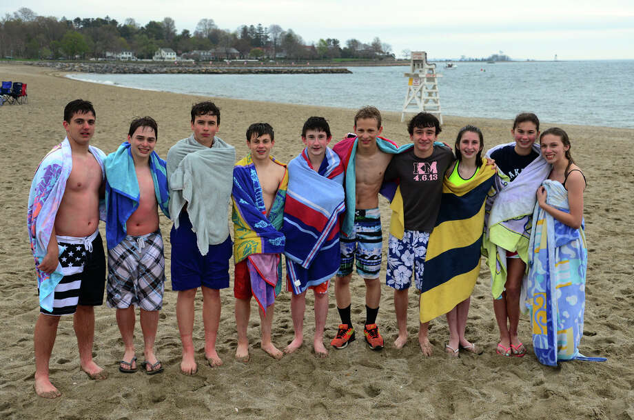 Fairfield Woods students pose on shore after a dip into the chilly water at Jennings Beach in Fairfield, Conn. on Friday May 9, 2014. They are taking part in a new fad among local kids in which friends nominate them to take a polar plunge within 24 hours. They prove they've done so by posting pictures and video clips to Instagram or other social media sites. They in turn nominate other friends to do the same. From left to right is Will Parisi, Jack King, Jacob Vonderlinden, Alex Steele, Sean Sigmund, Henry Prestegaard, John Kilcullen, Maggie McKeon, Katie Cetta, and Claire Christen. Photo: Christian Abraham / Connecticut Post