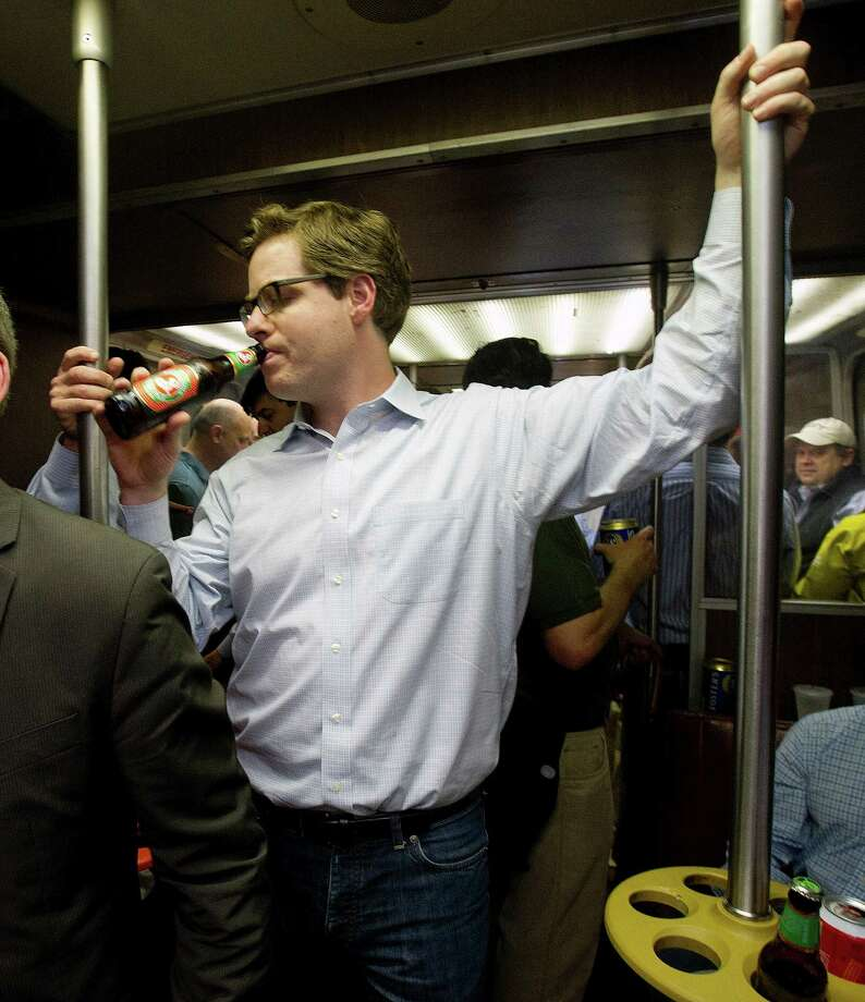 Conor Obyrne of Weston drinks a beer on a Metro-North bar car on the last night the cars, the last in the country, ran, on Friday, May 9, 2014. Photo: Lindsay Perry / Stamford Advocate