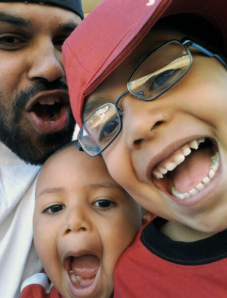 While freed, Rene Lima-Marin jokes around with children Justus, 7, and Josiah, 4, in Aurora, Colo. Photo: Courtesy Photo / Liam-Marin Family