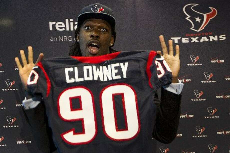 Jadeveon Clowney shows off his new Texans jersey after speaking to the media as he is introduced during a news conference on Friday. Photo: Brett Coomer, Houston Chronicle