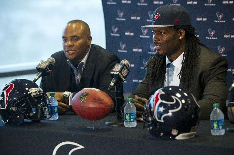 General manager Rick Smith, left, and Jadeveon Clowney, the Texans No. 1 draft pick, speaks to the media as Clowney is introduced during a news conference. Photo: Brett Coomer, Houston Chronicle