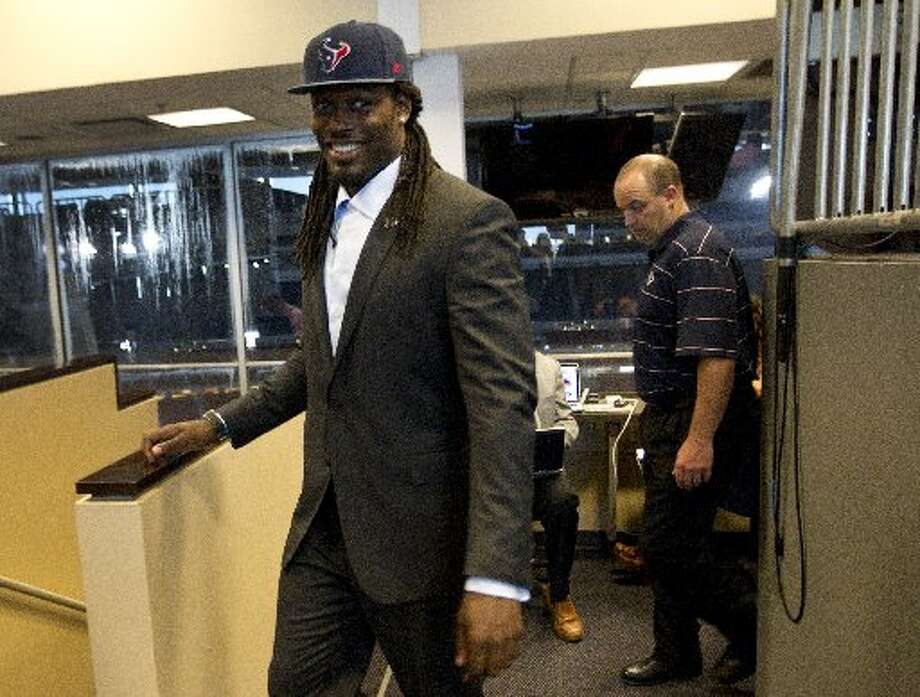 Jadeveon Clowney arrives to his introductory news conference followed by head coach Bill O'Brien. Photo: Brett Coomer, Houston Chronicle
