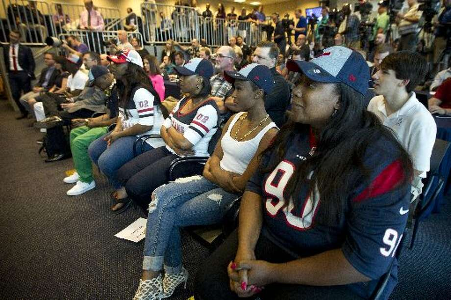 Josenna Clowney, Jadeveon's mother, sits in the front row during his introductory news conference. Photo: Brett Coomer, Houston Chronicle