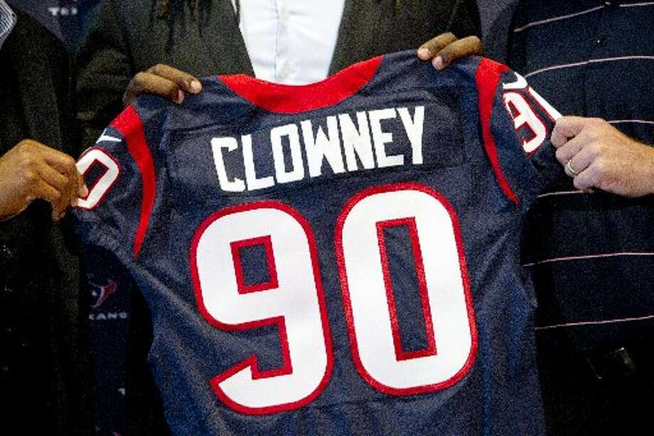 Jadeveon Clowney holds his new Texans jersey as he is introduced during a news conference. Photo: Brett Coomer, Houston Chronicle