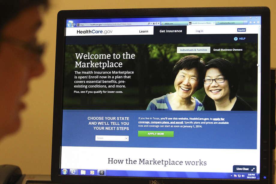 Latino survey respondents were more optimistic about the 2010 Affordable Care Act than whites. Photo: Kin Man Hui / San Antonio Express-News / ©2013 San Antonio Express-News