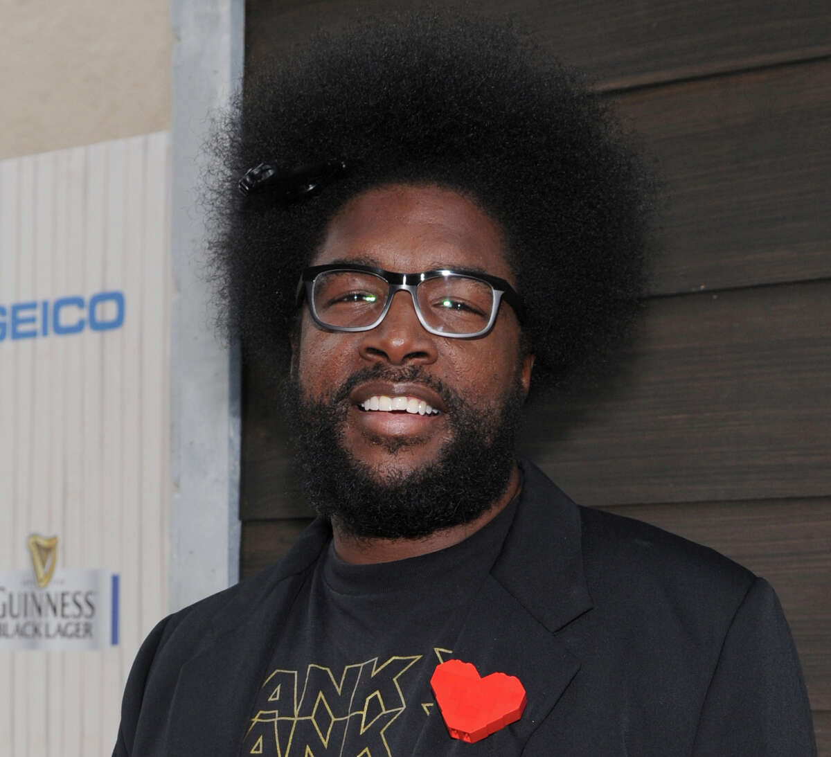 """FILE - In this June 8, 2013 file photo, Questlove arrives at Spike TV's Guys Choice Awards at Sony Pictures Studios in Culver City, Calif. The Roots leader is executive producing a music series for VH1 that will feature three artists performing simultaneously on one stage. """"SoundClash"""" debuts July 23, 2014, with Lil Wayne, Fall Out Boy and buzzed British group London Grammar. (Photo by Frank Micelotta/Invision/AP, File) ORG XMIT: CAET509"""