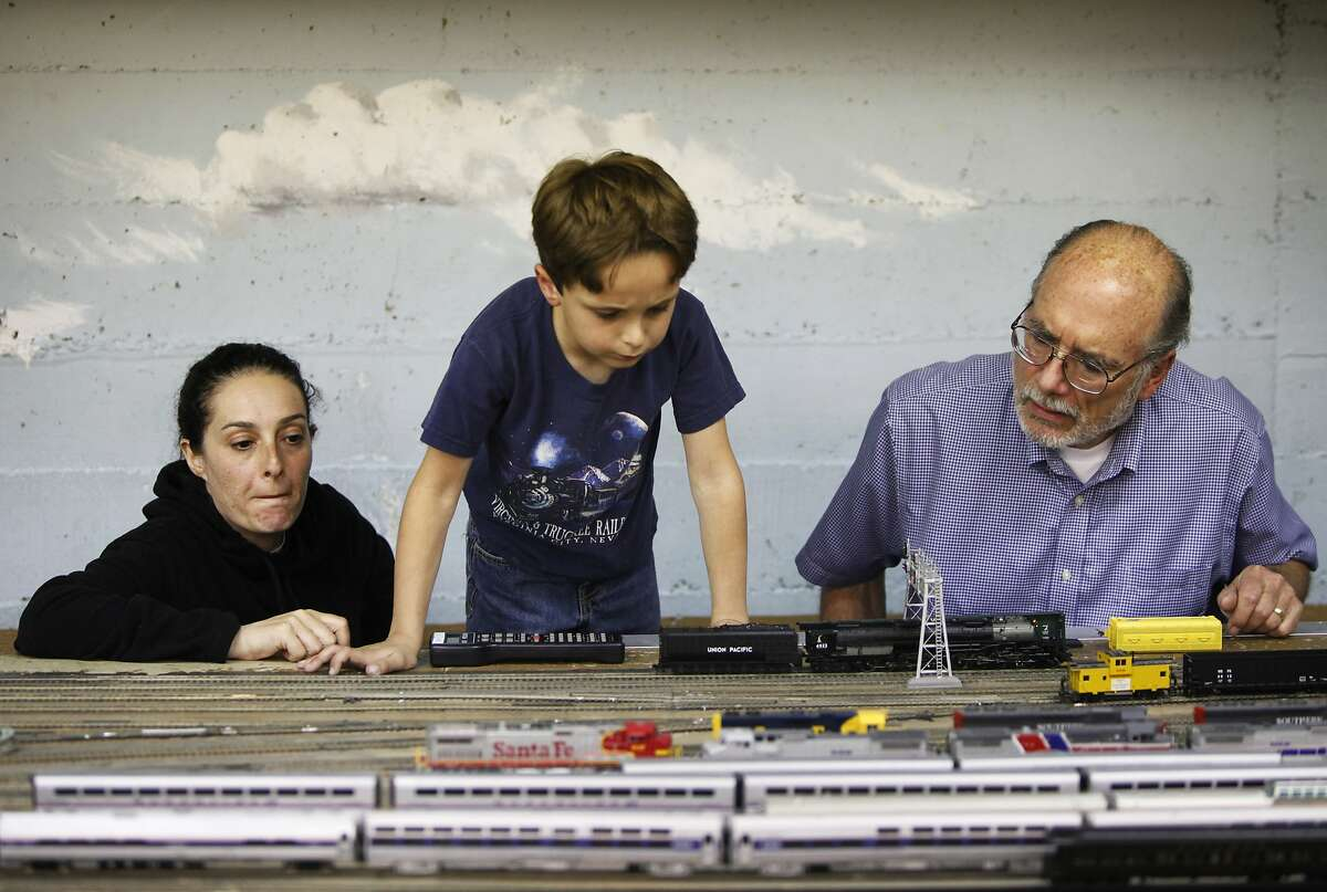 Orion Wagner, 6 and-a-half, surveys the Golden Gate Model Railroaders train layout as his mother, Miranda Tarbox looks on at the Randall Museum on May 7, 2014 in San Francisco, Calif. The Golden Gate Model Railroaders may have to dismantle their train layout before the end of the year to accommodate a renovation by the Randall Museum, where the layout is housed. At right is Jim Wilcox of the GGMRC.