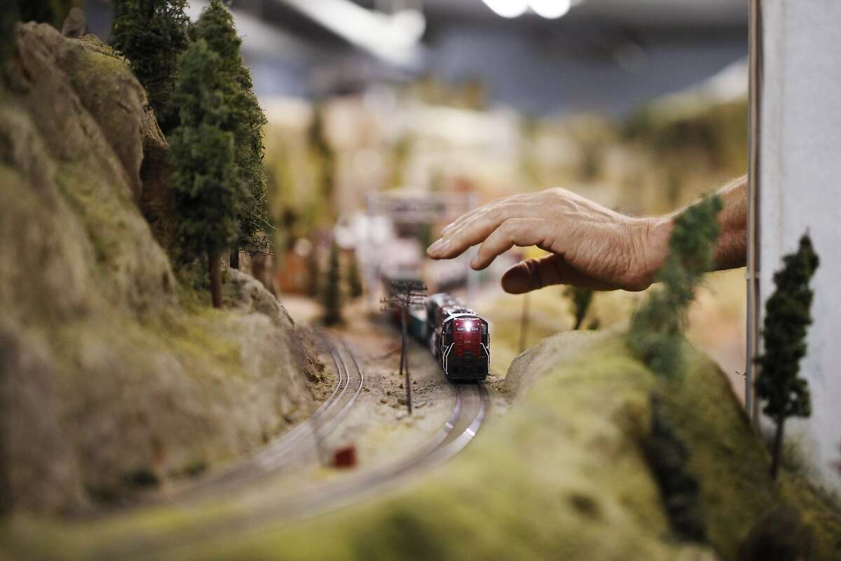 Bob Hansen adjusts a train that had become stuck on the train layout at the Randall Museum on May 7, 2014 in San Francisco, Calif. The Golden Gate Model Railroaders may have to dismantle their train layout before the end of the year to accommodate a renovation by the Randall Museum, where the layout is housed.