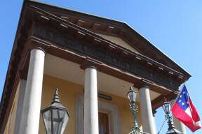 The Daughters of the Confederacy Museum, built in 1841, was the commercial center of Charleston for many years and served as a recruiting station during the Civil War. It's a National Historic Landmark, and considered one of Charleston's best examples of Greek Revival-style architecture.