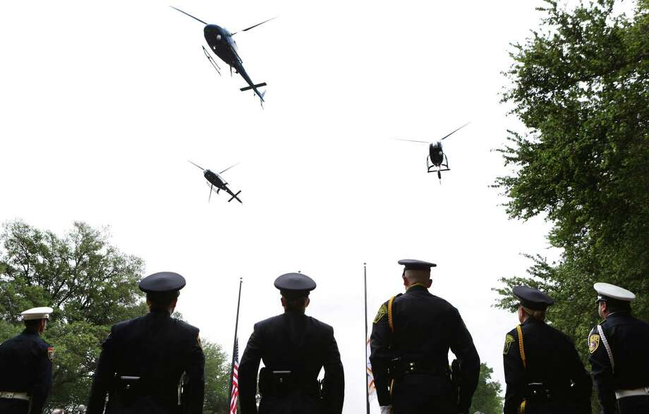 Members of the Police Department's honor guard stand at attention as three of the SAPD Eagle helicopters fly overhead during the ceremony, which was held at the department's training academy. Photo: Photos By Bob Owen / San Antonio Express-News / © 2012 San Antonio Express-News