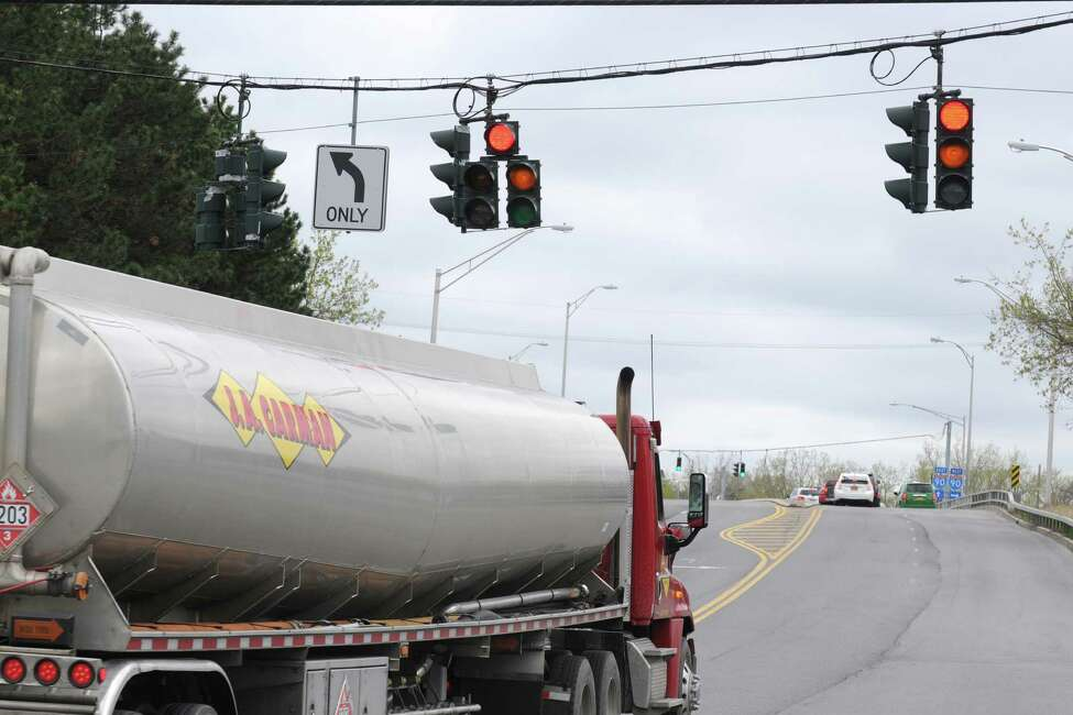 A vehicle is seen running a red light at Everett Road and Exchange Street Friday afternoon, May 9, 2014, in Colonie, N.Y. (Will Waldron/Times Union)