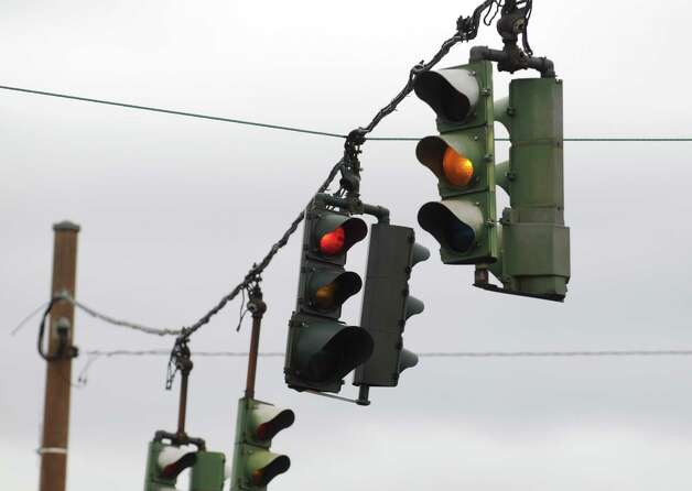 Traffic lights hang at the intersection of Shaker Road and Northern Boulevard Friday afternoon, May 9, 2014, in Albany, N.Y. A bill introduced Friday in the state Senate and Assembly would clear the way for city lawmakers to make Albany the first Capital Region community to install red-light cameras at up to 20 intersections. (Will Waldron/Times Union) Photo: WW