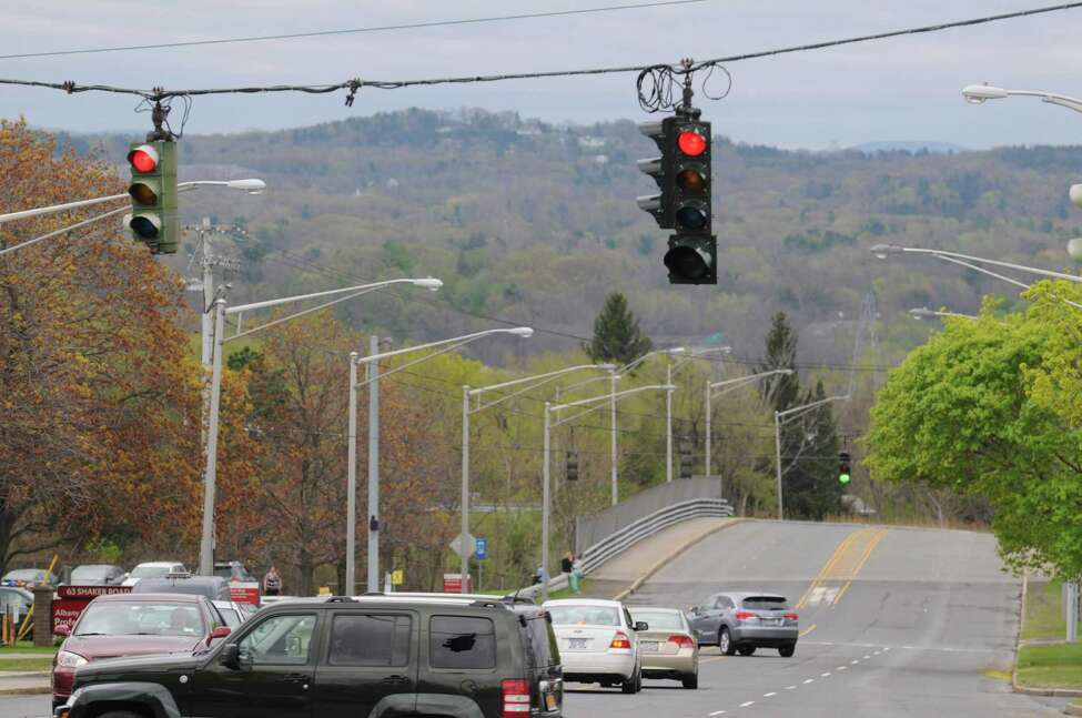 Traffic lights hang at the intersection of Shaker Road and Northern Boulevard Friday afternoon, May 9, 2014, in Albany, N.Y. (Will Waldron/Times Union)