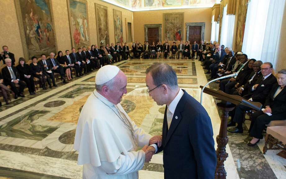 Pope Francis greets U.N. Secretary-General Ban Ki-moon at the Vatican, where in a speech he called for economic change. Photo: Associated Press / L' Osservatore Romano