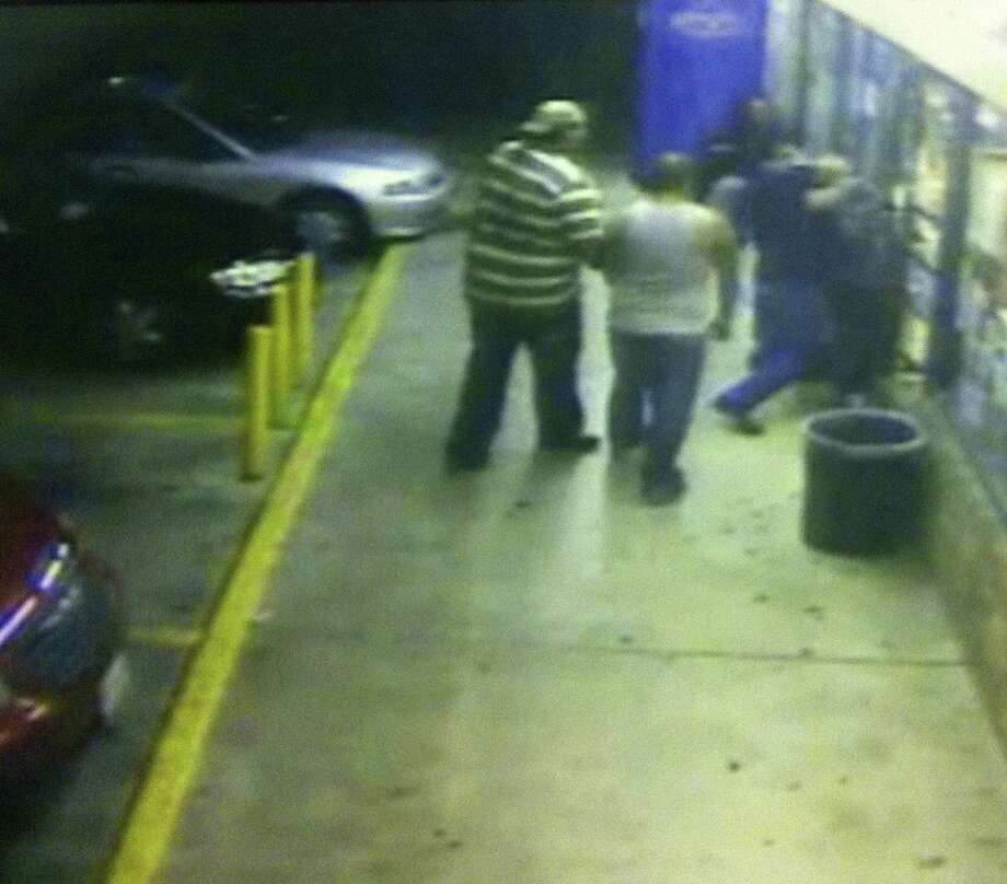 A security camera shows the beginning of the fatal October 2012 beating of Juan Romero outside Diamond Food Mart. Jose Velez (center) was given a 45-year sentence for his part. Photo: Courtesy Photo