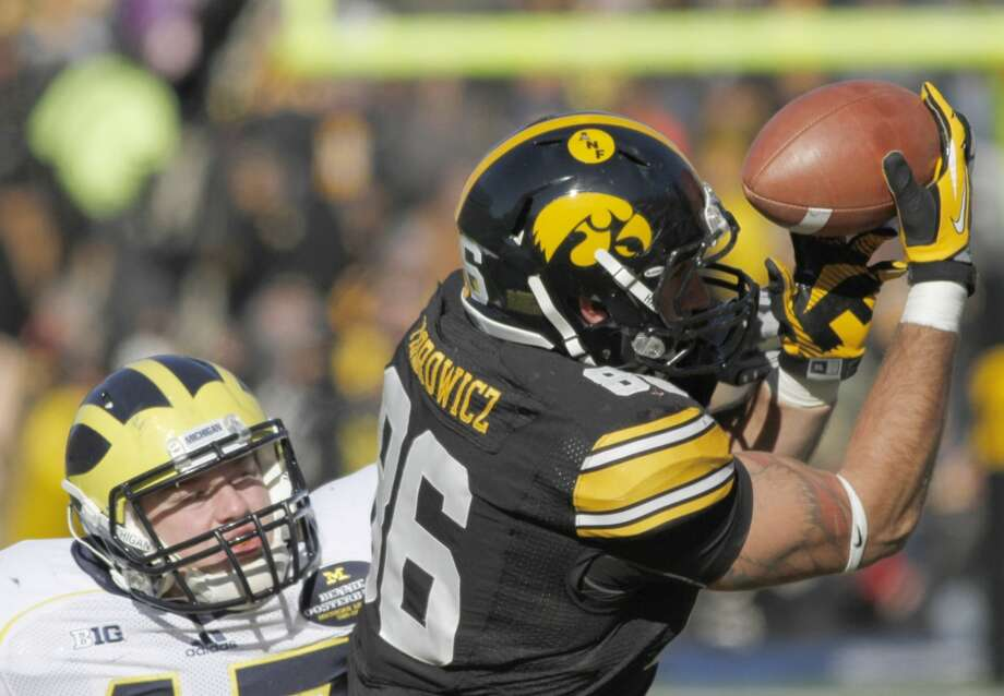 3rd round (65th overall): C. J. Fiedorowicz, TE, Iowa 6-6, 265.College career – Arguably under-utilized as a Hawkeye, he caught 95 passes, 10 for touchdowns, over three seasons while averaging about 10 yards per reception. Photo: Matthew Holst, Getty Images