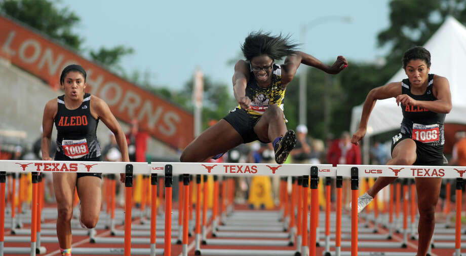 Fort Bend Marshall junior Jaelin Hatton, center, pushes to the finish line in the Class 4A Girls 100 Meter Hurdles during the UIL State Track & Field Championships at Mike A. Meyers Stadium in Austin on Friday. Photo: Jerry Baker, For The Chronicle