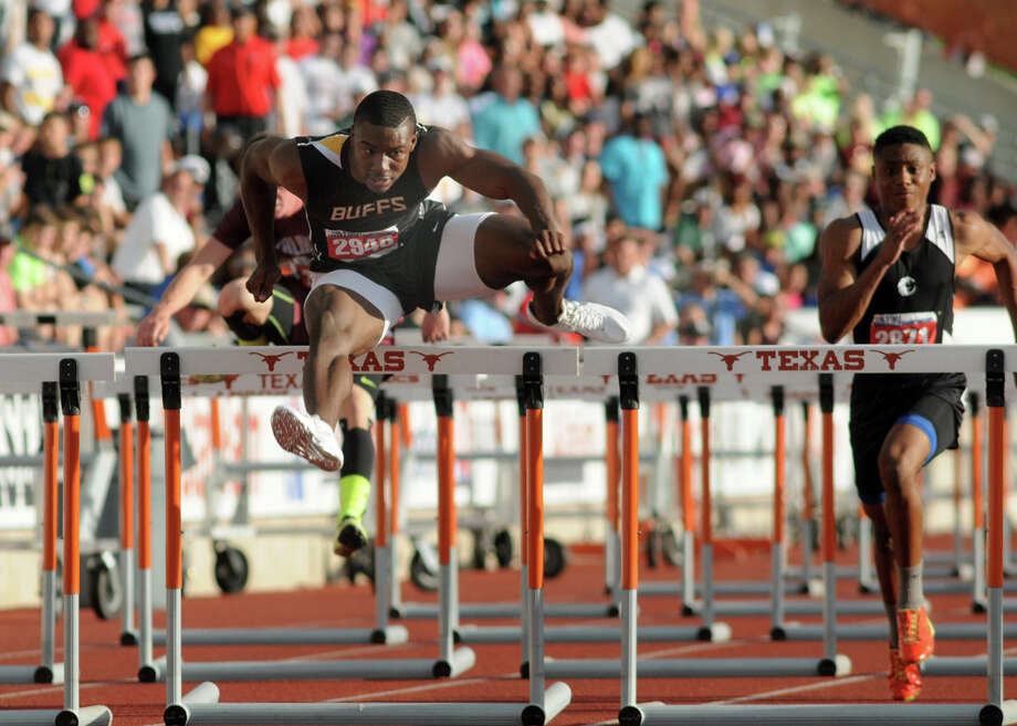 Fort Bend Marshall junior Kendall Sheffield pushes to a 1st place finish in the Class 4A Boys 110 Meter Hurdles during the UIL State Track & Field Championships at Mike A. Meyers Stadium in Austin on Friday. Photo: Jerry Baker, For The Chronicle