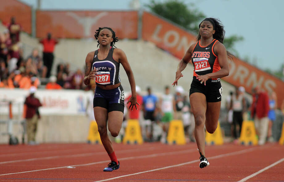 Texas City junior Melicia Smith, right, pushes to the finish line in the Class 4A Girls 100 Meter Dash during the UIL State Track & Field Championships at Mike A. Meyers Stadium in Austin on Friday. Photo: Jerry Baker, For The Chronicle