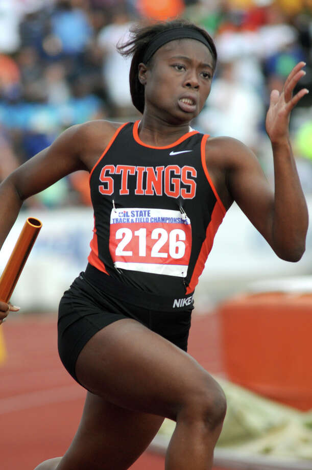Texas City junior Aerial Smith runs the first leg of the Class 4A Girls 4x100 Meter Relay during the UIL State Track & Field Championships at Mike A. Meyers Stadium in Austin on Friday. Photo: Jerry Baker, For The Chronicle