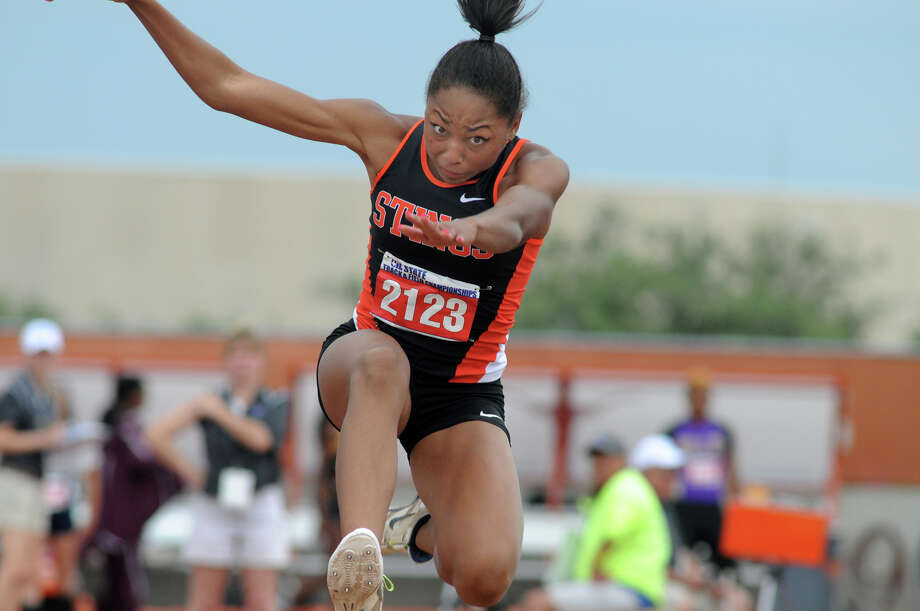 Texas City junior Asa Garcia competes in the Class 4A Girls Triple Jump during the UIL State Track & Field Championships at Mike A. Meyers Stadium in Austin on Friday. Garcia won both the Girls Long Jump and Triple Jump in Class 4A competition. Photo: Jerry Baker, For The Chronicle