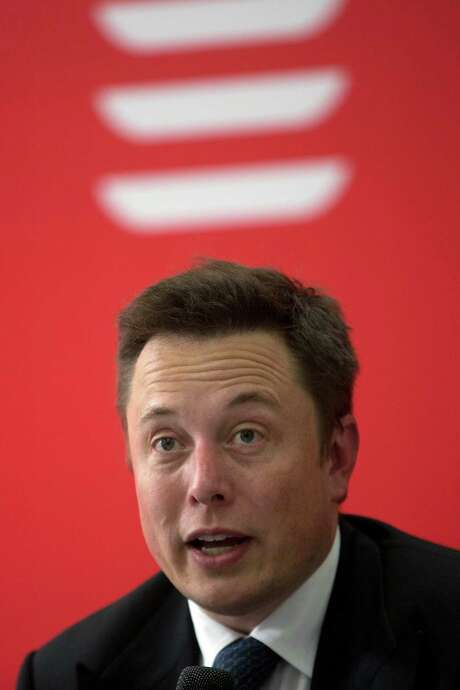Elon Musk, who oversees Tesla Motors, SpaceX and SolarCity, delivered Tesla's first six electric sedans last month in Beijing. Photo: Ng Han Guan, STF / AP