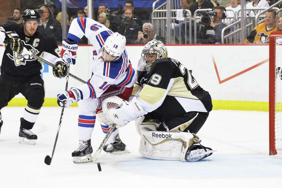 PITTSBURGH, PA - MAY 9:  Derick Brassard #16 of the New York Rangers scores a goal on goaltender Marc-Andre Fleury #29 of the Pittsburgh Penguins in the first period in Game Five of the Second Round of the 2014 NHL Stanley Cup Playoffs on May 9, 2014 at CONSOL Energy Center in Pittsburgh, Pennsylvania.  (Photo by Jamie Sabau/Getty Images) ORG XMIT: 488087699 Photo: Jamie Sabau / 2014 Getty Images