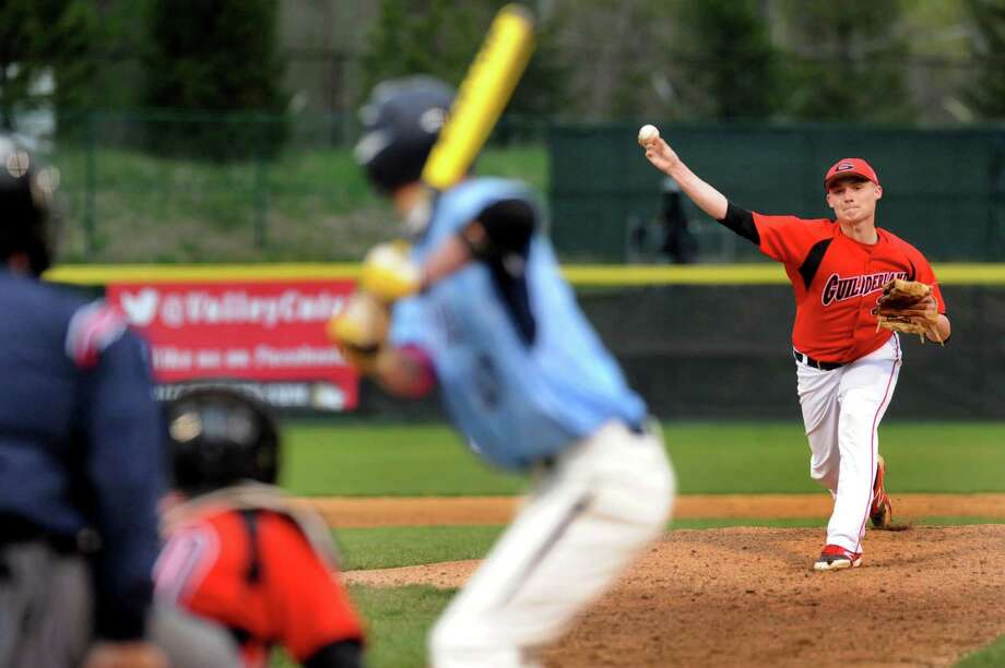 Guilderland's Matt Pierce, right, releases a pitch during their baseball game against Columbia on Friday, May 9, 2014, at Bruno Stadium in Troy, N.Y. (Cindy Schultz / Times Union) Photo: Cindy Schultz / 00026824A
