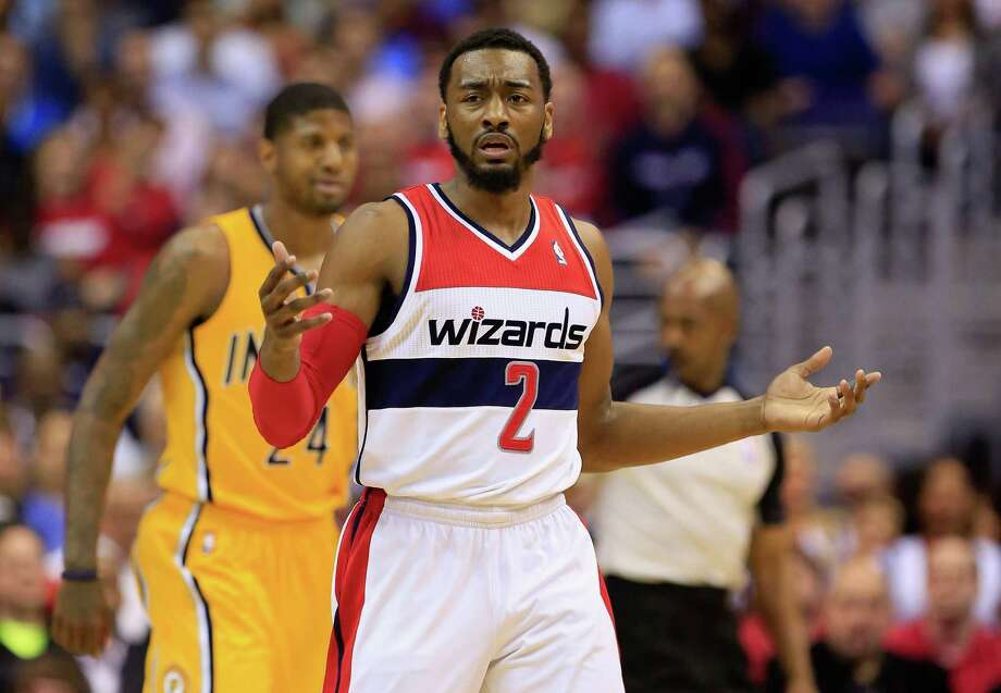WASHINGTON, DC - MAY 09: John Wall #2 of the Washington Wizards reacts after being called for a foul against the Indiana Pacers during Game 3 of the Eastern Conference Semifinals during the 2014 NBA Playoffs at Verizon Center on May 9, 2014 in Washington, DC. NOTE TO USER: User expressly acknowledges and agrees that, by downloading and or using this photograph, User is consenting to the terms and conditions of the Getty Images License Agreement.  (Photo by Rob Carr/Getty Images) ORG XMIT: 488649741 Photo: Rob Carr / 2014 Getty Images