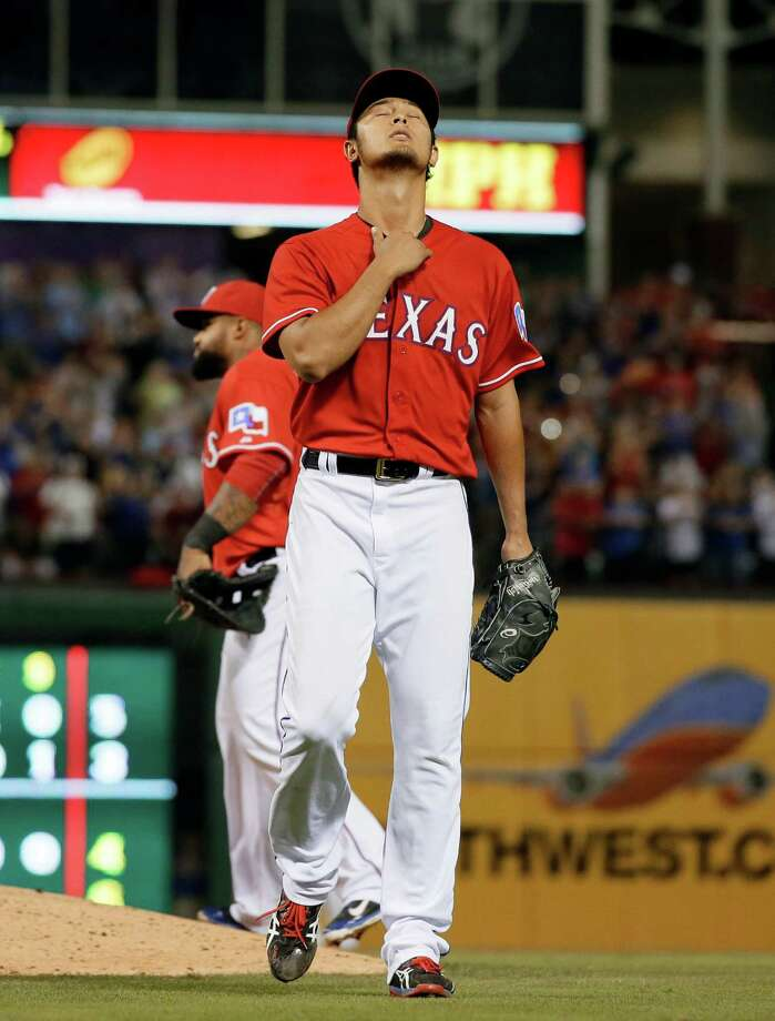Texas Rangers' Yu Darvish of Japan walks off the field in the ninth inning of a baseball game against the Boston Red Sox, Friday, May 9, 2014, in Arlington, Texas. Darvish took a no-hit bid into 8 and 2/3 giving up a single to David Ortiz in the 8-0 Rangers win.  (AP Photo/Tony Gutierrez) ORG XMIT: ARL117 Photo: Tony Gutierrez / AP