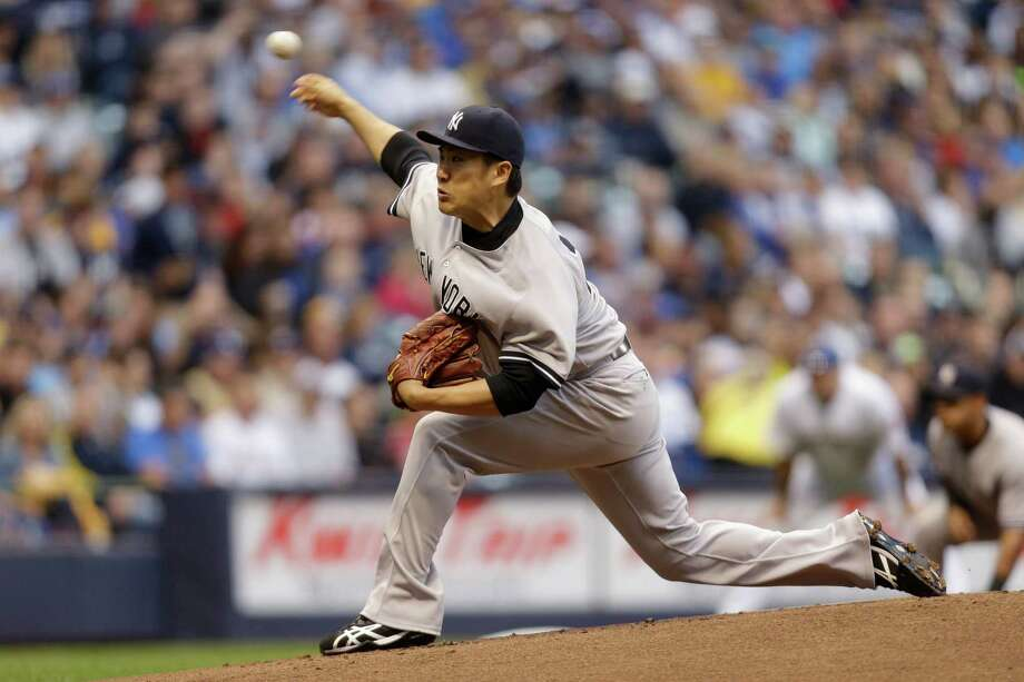 MILWAUKEE, WI - MAY 09: Masahiro Tanaka #19 of the New York Yankees pitches during the top of the first inning during interleague game against the Milwaukee Brewers at Miller Park on May 09, 2014 in Milwaukee, Wisconsin. (Photo by Mike McGinnis/Getty Images) ORG XMIT: 477583023 Photo: Mike McGinnis / 2014 Getty Images